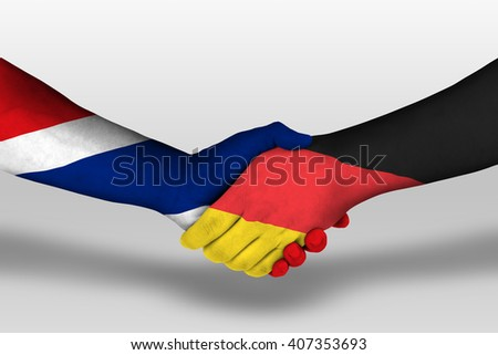 Handshake between germany and thailand flags painted on hands, illustration with clipping path.