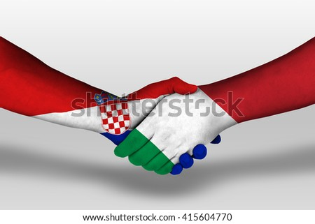 Handshake between italy and croatia flags painted on hands, illustration with clipping path. - stock photo