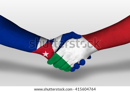Handshake between italy and cuba flags painted on hands, illustration with clipping path. - stock photo