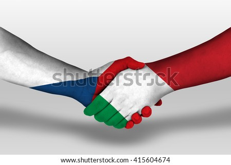 Handshake between italy and czech republic flags painted on hands, illustration with clipping path. - stock photo