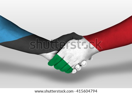 Handshake between italy and estonia flags painted on hands, illustration with clipping path. - stock photo
