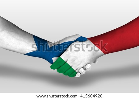 Handshake between italy and finland flags painted on hands, illustration with clipping path. - stock photo