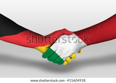 Handshake between italy and germany flags painted on hands, illustration with clipping path. - stock photo