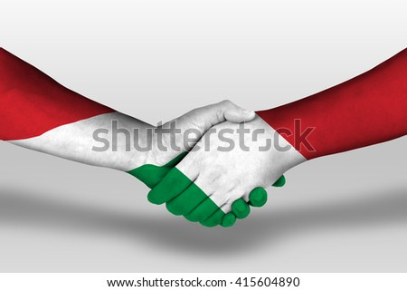 Handshake between italy and hungary flags painted on hands, illustration with clipping path. - stock photo