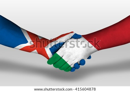 Handshake between italy and iceland flags painted on hands, illustration with clipping path. - stock photo