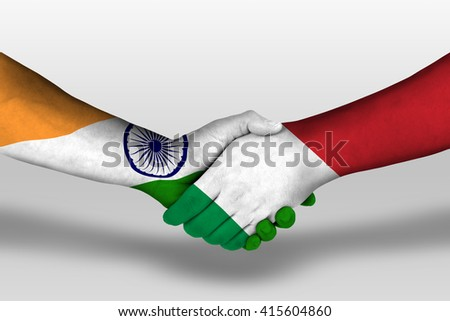 Handshake between italy and india flags painted on hands, illustration with clipping path. - stock photo