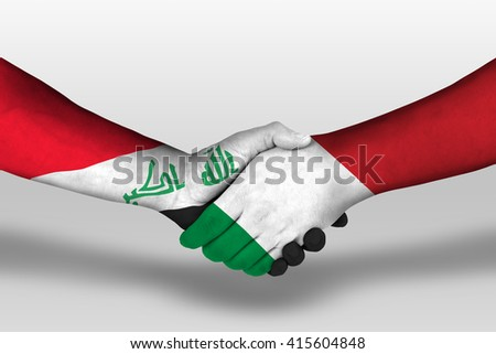 Handshake between italy and iraq flags painted on hands, illustration with clipping path. - stock photo
