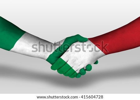 Handshake between italy and nigeria flags painted on hands, illustration with clipping path. - stock photo