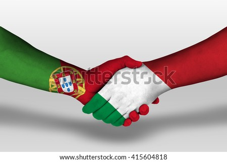 Handshake between italy and portugal flags painted on hands, illustration with clipping path. - stock photo