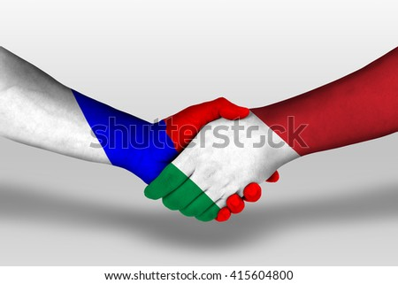 Handshake between italy and russia flags painted on hands, illustration with clipping path. - stock photo