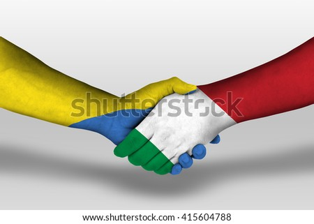 Handshake between italy and ukraine flags painted on hands, illustration with clipping path. - stock photo
