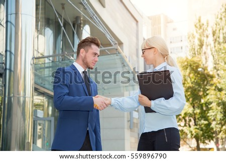 Handshake between man and woman. Business meeting. Business partners.