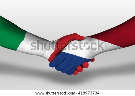 Handshake between netherlands and italy flags painted on hands, illustration with clipping path. - stock photo