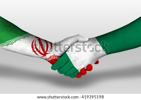 Handshake between nigeria and iran flags painted on hands, illustration with clipping path.