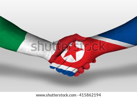 Handshake between north korea and italy flags painted on hands, illustration with clipping path. - stock photo