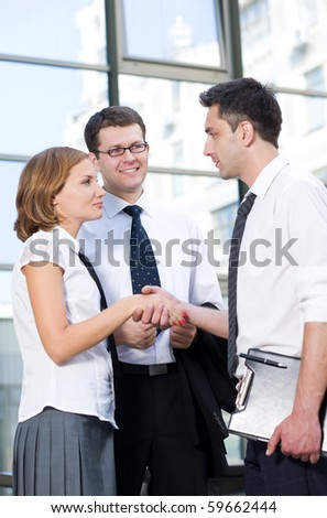 Handshake between office workers outdoor - stock photo