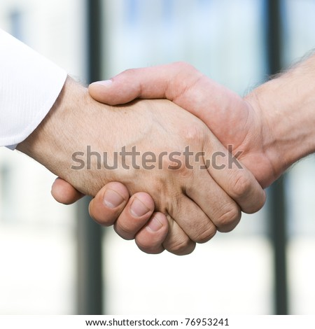 Handshake between office workers outdoor