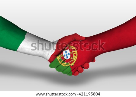 Handshake between portugal and italy flags painted on hands, illustration with clipping path. - stock photo
