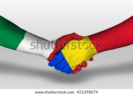 Handshake between romania and italy flags painted on hands, illustration with clipping path. - stock photo