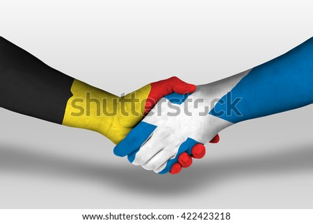 Handshake between scotland and belgium flags painted on hands, illustration with clipping path.