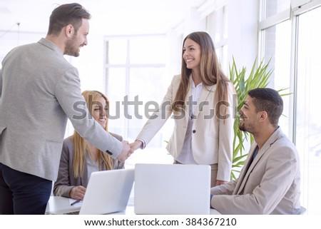 Handshake between two business executives - stock photo