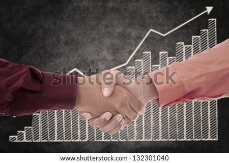 Handshake between two businessmen upon successful transactions - stock photo