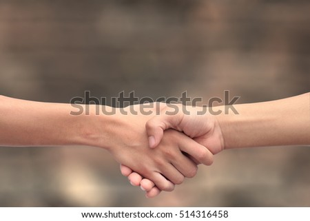 Handshake between two people with blur background