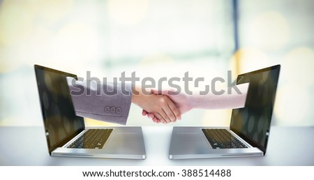 Handshake between two women against pies on a wooden table