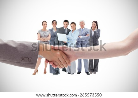 Handshake between two women against white background with vignette - stock photo