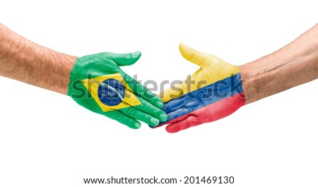 Handshake Brazil and Colombia - stock photo