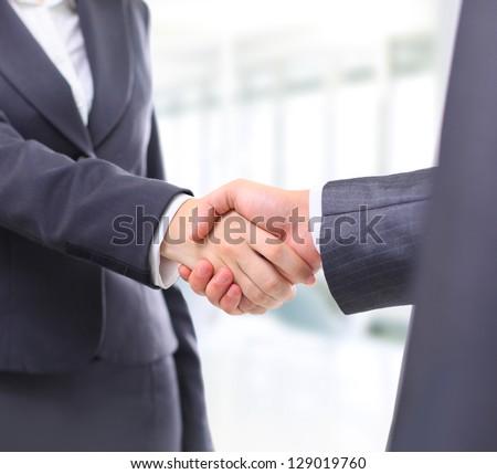 Handshake businessmen in the office. - stock photo