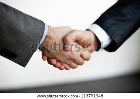 Handshake closeup of two businessman. - stock photo