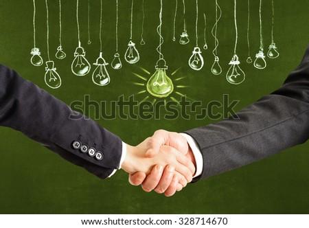 Handshake for a big idea - stock photo