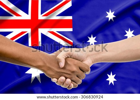 Handshake - Hand holding on australia flag background - stock photo