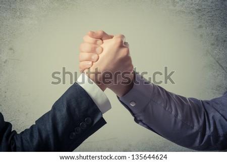Handshake - Hand holding on gray background - stock photo