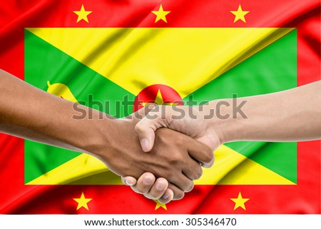 Handshake - Hand holding on Grenada flag background - stock photo