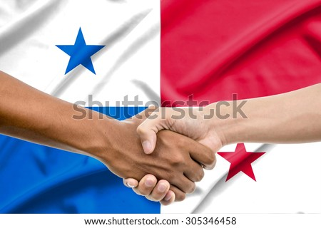 Handshake - Hand holding on Panama flag background - stock photo