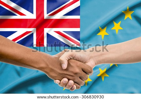 Handshake - Hand holding on tuvalu flag background - stock photo