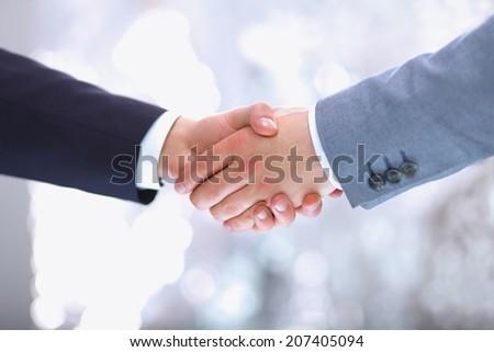 Handshake - Hand holding on white  - stock photo