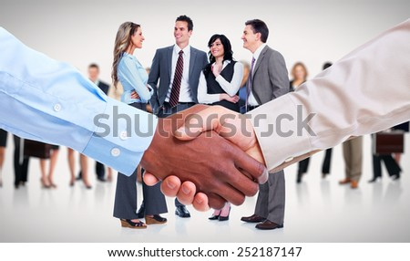 Handshake. Hands of businessman over team background.