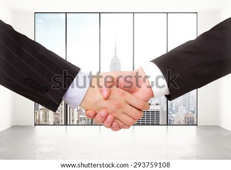 handshake in a light room with a blurred window