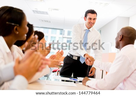 Handshake in a successful business meeting at the office - stock photo