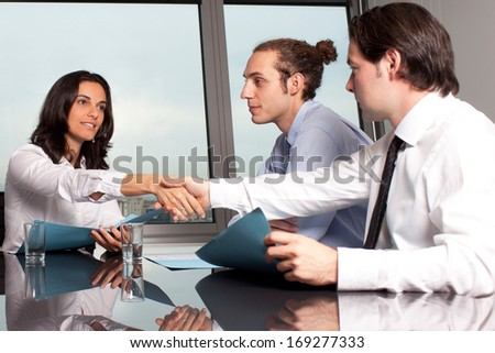 Handshake in board room