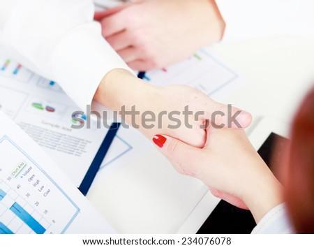 Handshake , isolated on white background. - stock photo