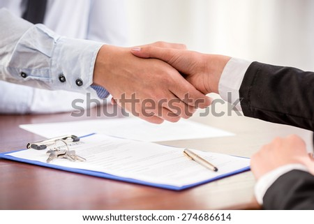 Handshake of a real estate agent and a client. - stock photo