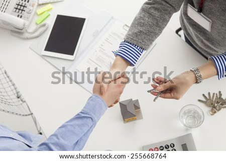 Handshake of a real estate agent and a visitor - stock photo