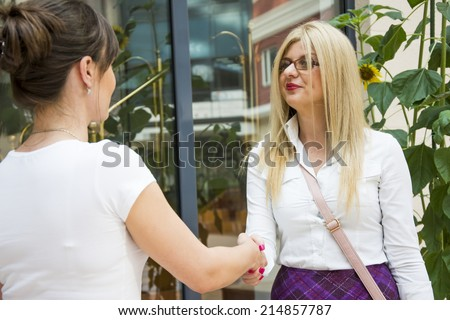 Handshake of a two businesswomen after closed deal