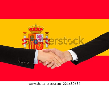handshake of a woman and business men in Spain - stock photo