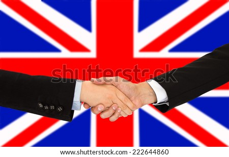 handshake of a woman and business men in UK - stock photo