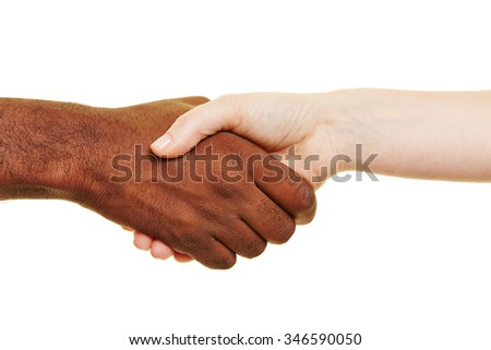 Handshake of african man and european woman for greeting